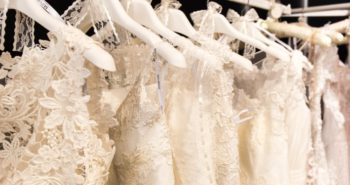 A same-sex couple says that a wedding dress designer turned them away, citing religious beliefs