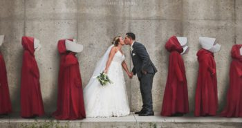 People are outraged by a couple's 'Handmaid's Tale'-themed wedding photo, which shows them kissing in front of the 'hanging wall'