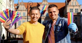 Gay couple fights prejudice and coronavirus in Poland by distributing rainbow face masks